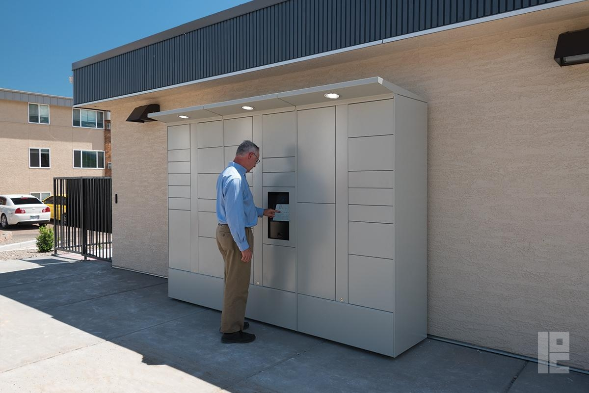 man using outdoor package locker